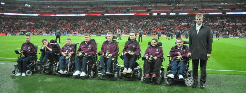 England's Powerchair Football Stars are presented with their Caps at Wembley Stadium